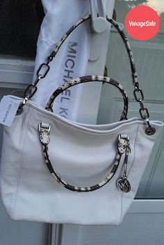 Brand new authentic Michael Kors ladies bag. Never used. Vanilla color, this year's popular color. New design of black, white and grey snake skin pattern strap and handle.Asking $300. Find this and other great deals locally in your community on www.varagesale.com
