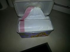 Old wipes container for trash bags.... good to put in drawer or under kitchen sink