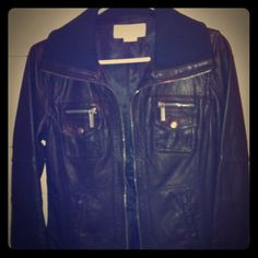 Authentic Michael Kors Leather Jacket NWOT. Gorgeous black leather Michael Kors Jacket with knit collar. New. Never worn. Mint condition. MEASUREMENTS: chest/waist about 32in all round. Jacket size SP. LAYING FLAT: jacket length 22in. Side to side 16in. Shoulder width 15in. Sleeve length 24 1/2in. Michael Kors Jackets & Coats