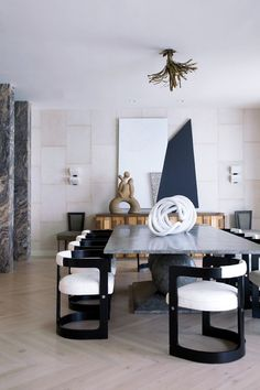 """Kelly Wearstler's ultra-glam beach house featured in Metropolitan Home magazine. That funky French chandelier is made with """"splayed copper branches that suggest seaweed."""""""
