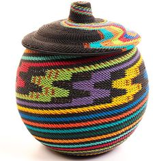 The past and the future are fused together in the creation of this beautiful basket, Zulu weavers have taken the intricate designs and incredible craftsmanship of their natural fiber baskets, and turned them into brightly-colored art from plastic-coated wire.