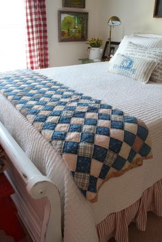 Great Indigo Farmhouse antique quilt and red buffalo check curtain panels.