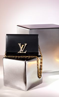 Bring this to any soiree and you'll be the talk of the night. This elegant leather purse features black with gold hardware, with a touch of python.