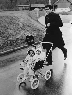 I'd love to know the story behind this pic. The kids in the pushchair look terrified.