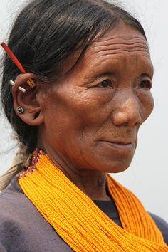 North East India ~ Nagaland | Konyak woman in Longwoa village | © Ronnie Dankelman