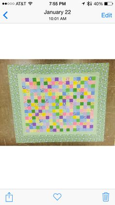 Simple baby quilt with green border