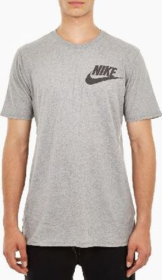Nike Grey Cotton Logo T-Shirt The Nike Cotton Logo T-Shirt for SS16, seen here in grey. - - - Crafted from premium cotton and cut to offer a relaxed fit, this classic t-shirt from Nike is finished with the brand™s instantly-recogn http://www.comparestoreprices.co.uk/january-2017-6/nike-grey-cotton-logo-t-shirt.asp