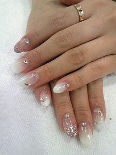 Simply girly nail (by Shibuya Tsu). Gradient-based white with glitter  rhinestones 5d61fc1b27ae