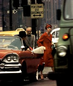 Anne St Marie dodges traffic in New York 1962 for Vogue by William Klein