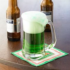 Add a colorful touch to your St. Patrick's Day celebration by making green beer. Place 2 drops of green liquid food coloring in the bottom of a beer mug or glass. Add the beer. No stirring needed. Green Cocktails, St Patrick's Day Cocktails, Fun Drinks, Yummy Drinks, Beverages, Holiday Cocktails, Leprechaun, Cheers, St Patricks Day Drinks