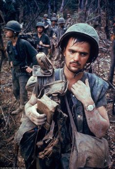 American Marines Worn down: An American Marine during Operation Prairie    Read more: http://www.dailymail.co.uk/news/article-2268602/Mud-blood-horror-The-brutality-Vietnam-War-captured-selection-stunning-images.html#ixzz2J6ASpP1N  Follow us: @MailOnline on Twitter | DailyMail on Facebook