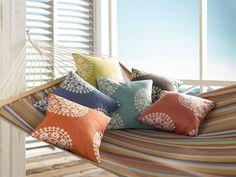 Echo Home fabrics for Kravet. Pictured: Merton Stripe (on hammock) and Torbali (on pillows).