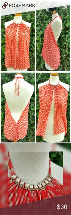 Chevron Print Halter Top Absolutely gorgeous chiffon chevron print top. Color is a salmon maybe coral. Neckline is a faux pearl with diamond rhinestones. Ties at the neck, fully exposed back.  Great over top a bikini or bathing suit! Keep it modest and wear with a simple camisole. Another option is wear a bandeau top underneath.  ***Last photo shows a slight defect in fabric that I had never noticed until recent. It's unnoticeable because the front is all pleated. Cannot see it at all. Tops…