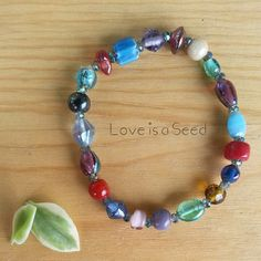 Love is a Seed  India Glass Bracelet by LoveisaSeed on Etsy, $6.50