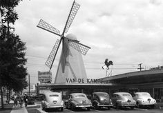 Van De Kamps Bakery and Coffee Shop with drive-in service, ca. 1945. This restaurant was located at the corner of Fletcher Drive and San Fernando Road in Atwater Village. It was designed by local architect Wayne McAllister in the Streamline Moderne style with neon trimming the roof line and iconic windmill blades. T