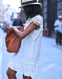 White lace dress leather bag and panama hat
