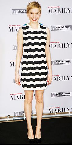 Michelle Williams attended a Berlin press event for My Week with Marilyn in a striped Kenzo shift and cap-toe pumps.