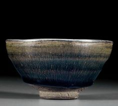 An exceptional Jianyao 'Hare's fur' tea bowl and a tixi lacquer stand bowl, Southern Song dynasty (1127-1279)