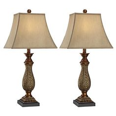 This lovely set of two table lamps boast a two-tone golden finish topped by linen-style shades.