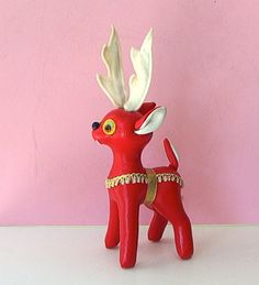 ADORABLE & PRISTINE vintage 1950s - 1960s Red Leatherette VINTAGE CHRISTMAS REINDEER w glass eyes - super cute - ALL ORIGINAL & PERFECT. Tagged MADE IN JAPAN. This cutie is a brilliant bright red leatherette w white felt antlers and white leatherette lined ears & tail - lots of detail & very appealing! Face is really cute w white felt smiling mouth, amble glass eyes w yellow & pastel green felt backgrounds, & black plastic nose. Decked in gold & white braid harness w gold metallic ribbon…