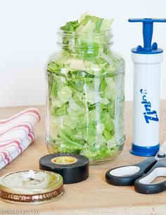 How To Vacuum-Pack Salad in a Jar for Less is an inexpensive way to vacuum-pack lettuce in Mason jars with a thumbtack, electrical tape and a hand pump. Salad In A Jar, Soup And Salad, Glass Jars, Mason Jars, Pots, Meals In A Jar, Preserving Food, Food Storage, Food Hacks