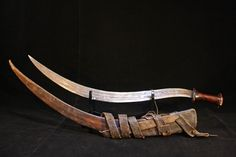 Antique Shotel Sword with Wood Grip and Leather Scabbard. Just one of the rare and unique collectibles you'll find at Esoteric Stuff. Swords And Daggers, Knives And Swords, Indian Sword, Greek Pantheon, Blacksmith Forge, Sword And Sorcery, Arm Armor, Fantasy Weapons, Creature Design