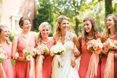 "coral bridesmaid dresses with twisted ""pearl"" necklaces"