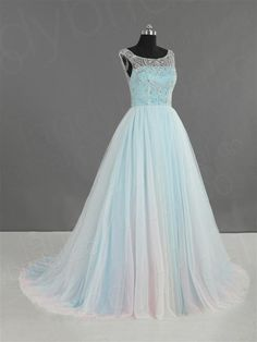 Snow blue is another favorite color by many brides and when this wedding dress is made of comfortabally soft tulle, it totally touches the spirit of beauty.