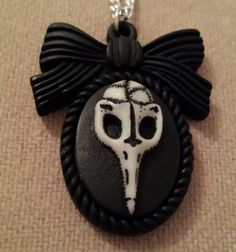 Check out this item in my Etsy shop https://www.etsy.com/listing/210287148/birds-skull-small-resin-cameo-pendant