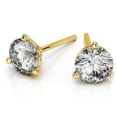 The Round Martini Three-Prong Stud Earrings in classic Yellow Gold exudes class and style via its slim elegant setting.  www.brilliance.com