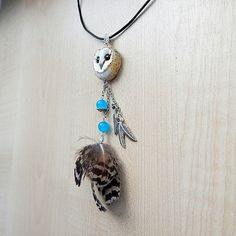 Barn #owls pendants I made of polymer clay, chains, real feather and blue aventurine, waxed  cord. The diameter of the  1 pendant is 2.5 cm or 0.98 inches , length  pendant ... #polymerclay #animaltotem #jewelryanimals #labryinth