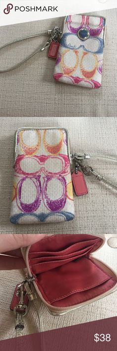 Coach Wristlet Multicolored coach wristlet, fits iPhone 5. Lightly used. Has stain on front, but barely noticeable Coach Bags Clutches & Wristlets