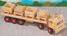 """Fagus Wooden Transport Truck with 2 Pallets & 2 Containers - Made in Germany by Fagus. $82.59. Sturdy 23.6"""" Transport Truck. Includes: 2 pallets, 2 containers and 3 peg figures. For indoor play only.. Made inGermany of beech wood.. A great big, steerable wooden articulated transport truck by Fagus, with 2 pallets, 2 stacking boxes, and three wooden figures. Measuring almost 24 inches long, this is truck provides hours of indoor play. The wonderful wooden cars, trucks..."""