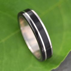 Un Lado Asi Coyol Wood Ring - Ecofriendly wood wedding ring, handmade with recycled sterling silver and sustainable coyol seed wood.