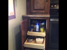 Not enough room on your kitchen for a tall #pantry cabinet? Extend your wall cabinet down to the counter and use sliding #shelves down below.   |   YouTube.com