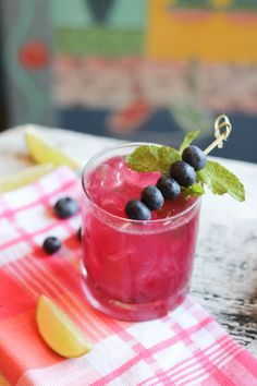 Blueberry Mojito recipe from Lovehappyhour.com #cocktails