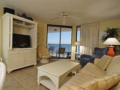 The cheery colors create a pleasant atmosphere when you and up to 7 others #vacation at Phoenix III 3088, gulf-front in Orange Beach, AL. Living room and master bedroom open to the balcony with expansive views of the white-sand #beach and beautiful blue and green waters of the gulf. The indoor and outdoor pools, hot tub, tennis, racquetball, exercise room, sauna and BBQ area make it easy to occupy your non-beach time. #OrangeBeach #GulfShores http://www.meyerre.com/property/Phoenix_III_3088