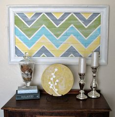 Here is the idea to craft this incredibly easy project for one of the focal point of the room. The project only needs some old stuff to be repurposed and redesigned like an old wooden frame that is painted in antique silver color and the pallet wood that is painted in any pattern you like and the art is fixed inside the frame to be displayed.