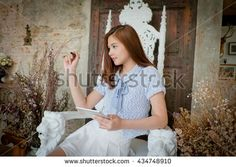 Woman  with tablet computer,chair on the bench .With space for text ads. On the…