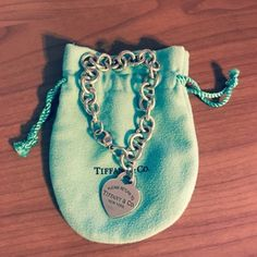 100% authentic return to Tiffany charm bracelet 100% authentic return to Tiffany charm bracelet-could use a cleaning and polish. fits relatively small wrists. have the toggle necklace as well, willing to bundle Tiffany & Co. Jewelry Bracelets