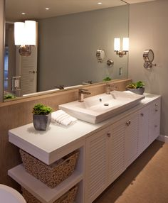 eclectic bathroom : vanity doors : open shelving : sink : wall color
