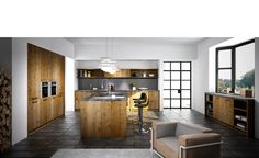 Cuisine Design - Bois - Artwood 1. Chaleur et force de caractère: plan de travail et crédence assortis, façades et caissons intérieurs de même coloris, autorisant des espaces ouverts. La hotte est astucieusement dissimulée derrière une façade prolongée d'étagères décoratives.