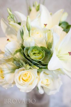 White rose wedding bouquet with green cabbage succulent and ornamental grasses