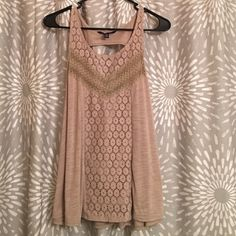 Soft and sexy AE tank EXCELLENT condition! Such a lightweight tank that is flowy with no hugging! This tank has lace embellishment in the front and a key hole in the back! No holes, stains or wear! Smoke free home.  American Eagle Outfitters Tops Tank Tops