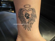 paw print tattoos with angel wings | View More Tattoo Images Under: Dog Tattoos