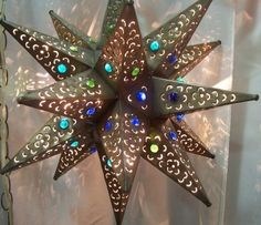Flowercut Bronze Starlight with Blue Green Marbles - Stargate Cinema Star Lanterns, Candle Lanterns, Candles, Porch Lighting, Cool Lighting, Mexican Patio, Tin Star, Green Marble, Boho Decor