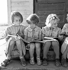 Girls of Lincoln Bench School study their reading lesson. Near Ontario, Malheur County, Oregon, 1939 dorothea lange