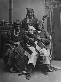 An old photograph of a Group of Zuni Chiefs with Boy.