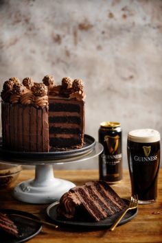 This chocolate cake is layered with a creamy chocolate ganache frosting and the cake layers are soaked in a Guinness syrup and finished with a ganache pouring sauce. Chocolate Guinness Cake, Chocolate Cake, Guinness Kuchen, Super Torte, Cake Recipes, Dessert Recipes, Dessert Ideas, Baking Recipes, Chocolate Ganache Frosting