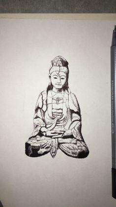 A broken sculpture of Buddha